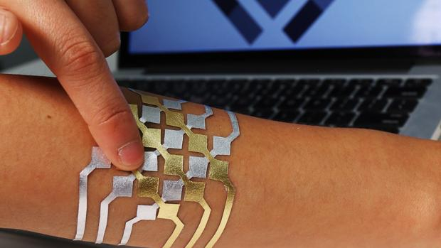 Control Your Technology With a Shiny Tattoo