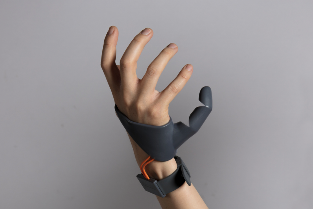Forget Third Arms, What About a Third Thumb?